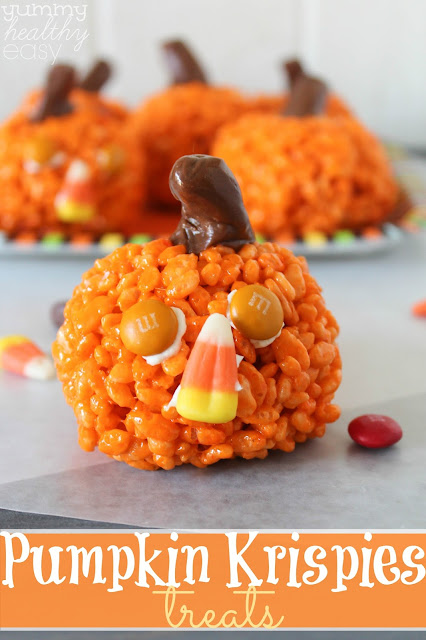 Pumpkin Krispies Treats (with candy corn noses!) by Yummy Healthy Easy