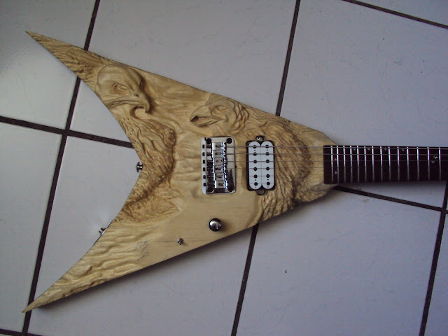 carved electric guitar guitarra escultura capital inicial