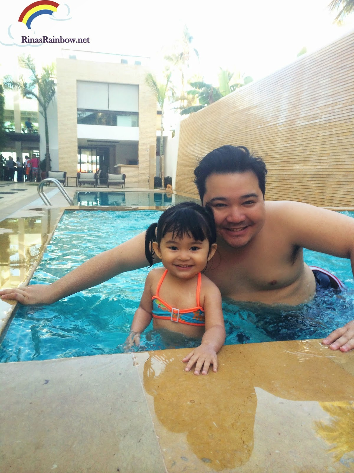 father and daughter swimming