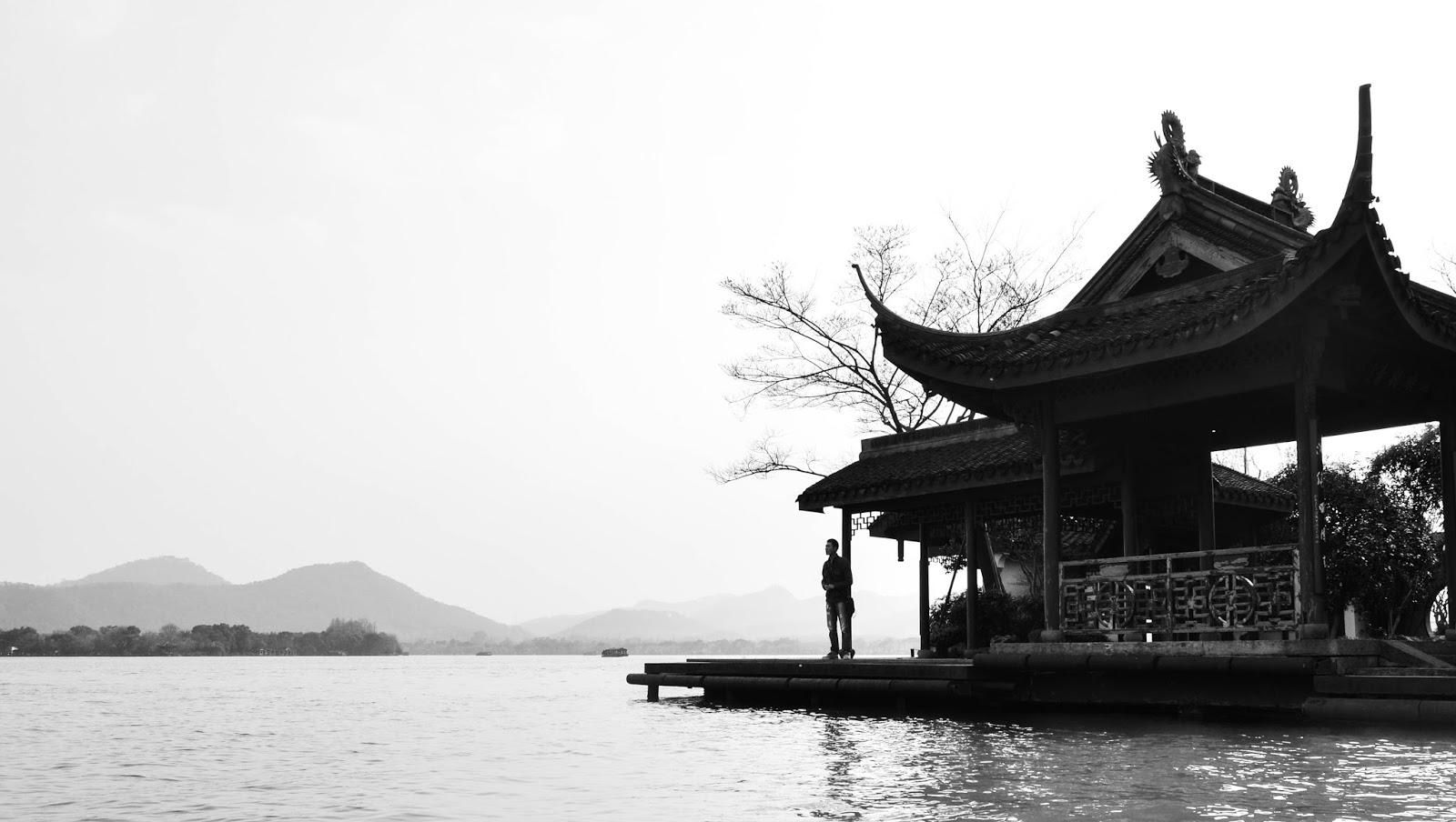 photography black and white man in hangzhou lake