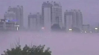(China) - Ghostly mirage appears over river in Huanshan City