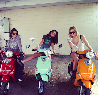 girls ride moped scooter