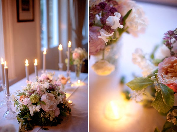 Wedding at London Rowing Club on the Thames. Candles and pink flowers