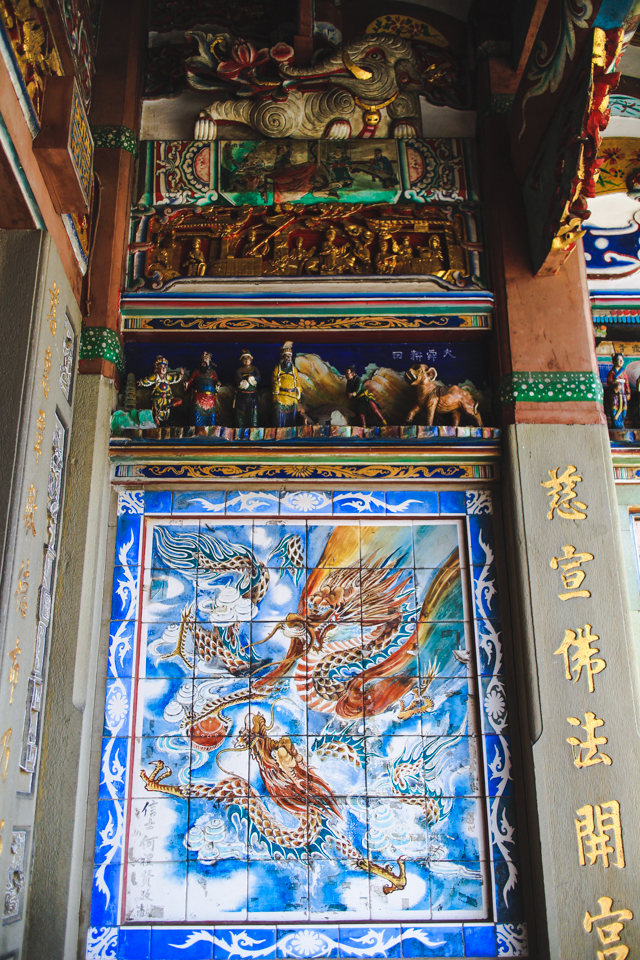 intricate carvings and colorful paintings cover the temple's interior and entry | Beipu, Taiwan