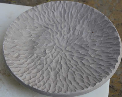 carved pottery plate