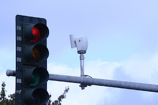 Cameras next to traffic lights are spying on you!
