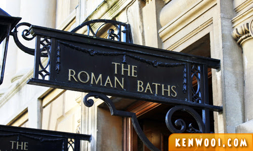 bath roman baths sign