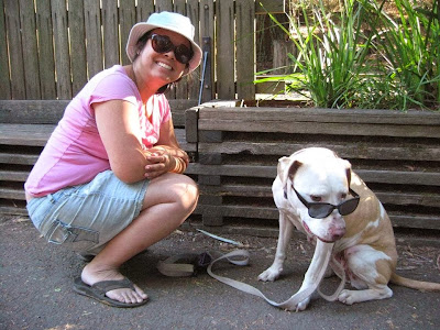 Photo of Te-Ling and her dog Lady both wearing sunglasses outside