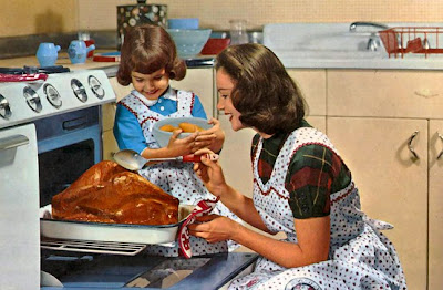 Vintage mom & daughter roasting turkey