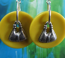 Big drop dangle earrings with silver pewter charms layered over large yellow buttons