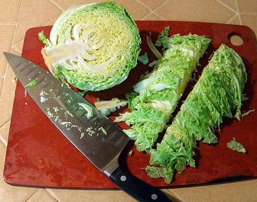 Cutting board with thin, even, bite-sized cabbage demo