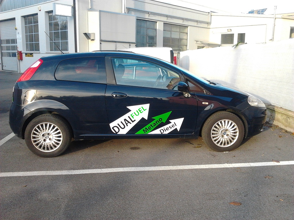 Experimental vehicle grande punto dual fuel 1 3mj with dpf