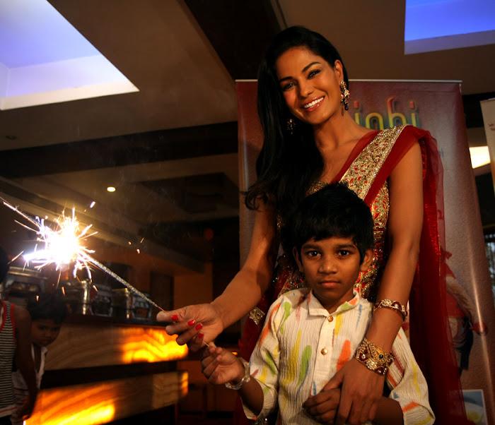 veena malik adopts payal kamble seven year old girl photo gallery