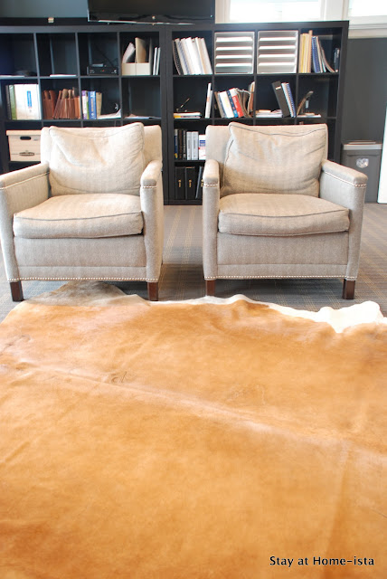 Ikea cowhide rug in a masculine office