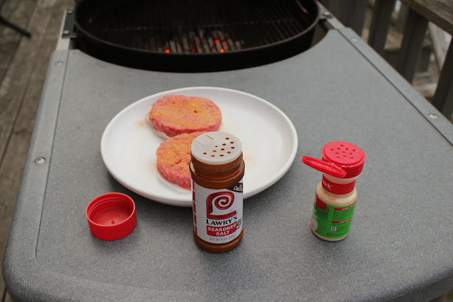 Seasoning burgers with Lawry's Seasoned Salt and McCormick Garlic Powder