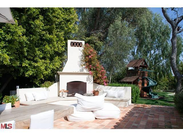Trisha troutz spanish style in brentwood for Spanish outdoor fireplace