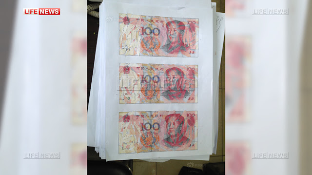 Китаец и его жена несколько месяцев склеивали 21 тысячу долларов