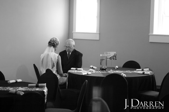 photo of prayer before the wedding ceremony at Twelve West Main