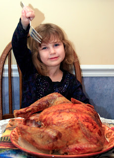 Girl eating turkey holiday food