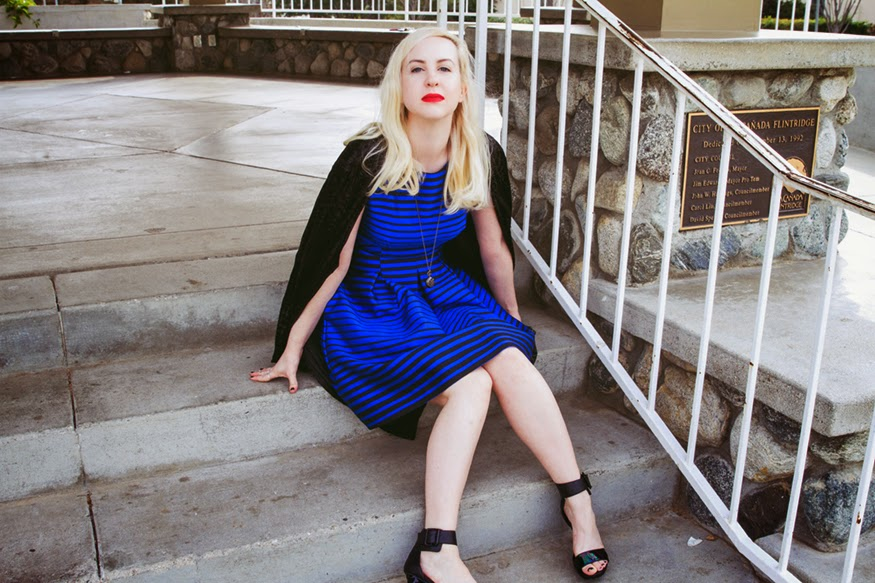 Corey Lynn Calter striped blue dress, red lips, and blond