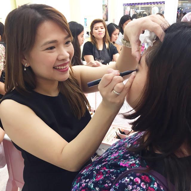 A photo of Nikki Tiu doing Makeup at Benefit SM MEgamall