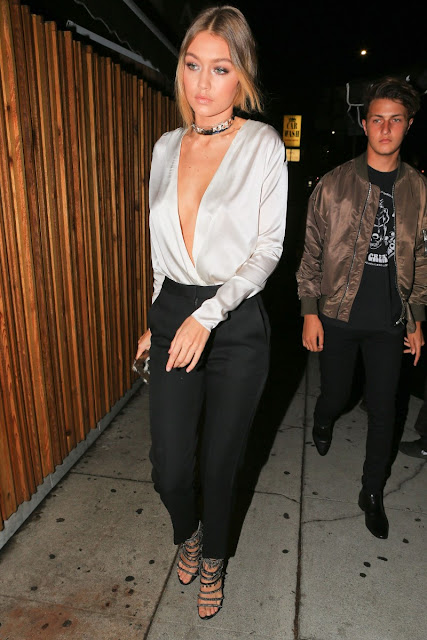 Gigi Hadid sexy braless cleavage at party event photo 1