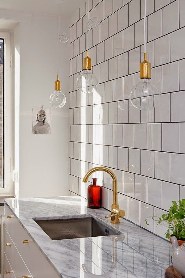 gold fixtures in the bathroom kitchen and an update design