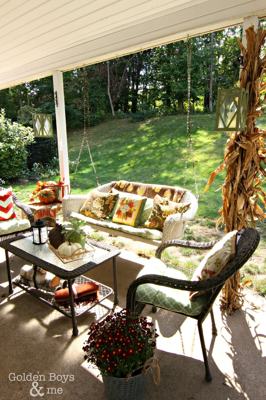 Fall decor with porch swing via www.goldenboysandme.com