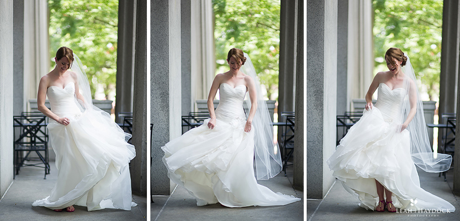 Bride dancing and moving to show off her wedding dress