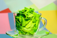 Green tea leafs in cup
