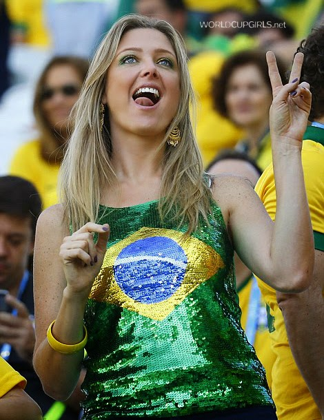 Beautiful Brazilian girl watching the World Cup 2014