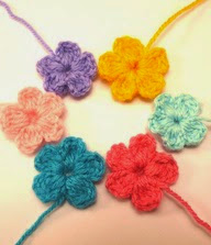 http://www.ravelry.com/patterns/library/little-flowers-by-lydienne