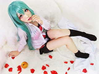 Monpink cosplay as Vocaloid Hatsune Miku