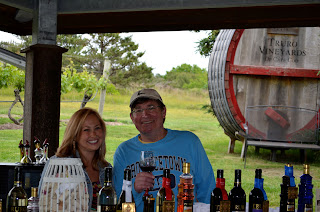 Charlie with wine tasting presenter Rebecca and bottles of wine.