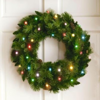 Colorful lighting decoration of X mas lights in Christmas wreath hanging to wall image