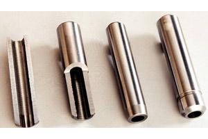 Guida valvole in sezione con dettaglio della particolare rigatura interna per controllo lubrificazione stelo valvola