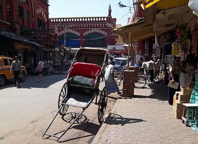 hand rickshaw in busy market
