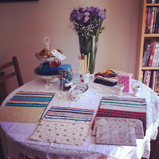 Table set up for sewing workshop at the hen party with material and zip options