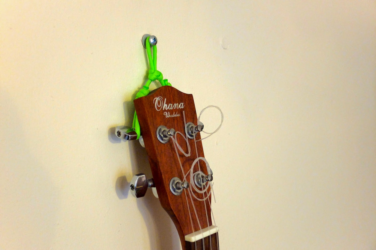 ukulele hanging on wall