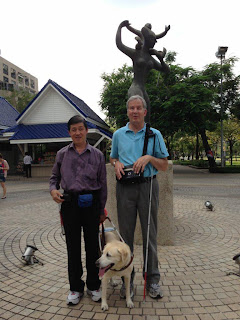 Mike and Cheng are providing GPS tours outside the Imperial Queens Park hotel at the World Blind Union in Bangkok.