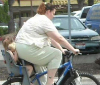 funniest pictures: fat woman on bicycle with baby behind