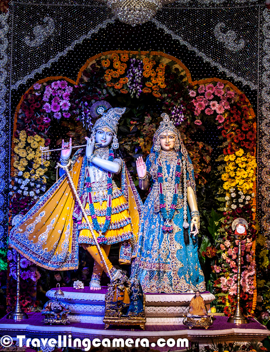 Few days back we shared a Photo Journey about Prem Mandir in Vrindavan. Prem Mandir is really a beautiful place in vrindavan and looks more like a tourist spot rather than a spiritual place, which doesn't mean that temple has less spiritual value. Prem Mandir is one of the most popular temples in Virndavan and this Photo Journey will show it's interiors.Here is a photograph of Prem Mandir in vrindavan with huge lawns all around and colorful spaces, which are well maintained. Above photograph shows a man working in lush green lawn and trying to ensure that plants are in good shape.This is how various statues are carved in various marble pillars and Walls of Prem Mandir in Vrindavan. From a distance, most of them look real and specially the ones with lot of people in one creation having 3D effect because of different placementsLord Krishna, who takes the main place inside Prem Temple of Vrindavan. This Statue of Lord Krishna is just in front of main gate of Prem Mandir...  This whole area looks amazing with wonderful lighting all around !!Here is a view of Lord Krishna and Radha-Rani statues from main entry gate of Prem Mandir !!! Inside the temple, paths are properly marked which guide everyone about the way they need to follow to have peaceful darshan of Lord Krishna/Radha on ground floor and Shri Ram/Sita on upper floor of the templeA closer look at the statues of Lord Krishna and Radha Rani with lot of people standing in front of them !Here is one of the marvelous creation carved out of marble rocks and looks real from distance. Each portion in these creations is placed very well to have 3D perspective from longer distances. This photograph is shot with a zoom lens otherwise it's not allowed to go closer to these creation, jut to maintain disciplineEach and every portion of Prem Temple at Vrindavan is quite vibrant and colorful. The whole campus is designed very well and maintained with same spiritHere is a photograph clicked from first floor, showing people sitting on ground floor and enjoying spiritual music at Prem Mandir of Vridnavan !!This one is most popular stuff of Prem Temple. During morning ride in Auto, we kept hearing about this only... Something very glittery, colorful and a portion of it keeps rotating..There wea some interesting lighting stuff inside the Prem Temple.
