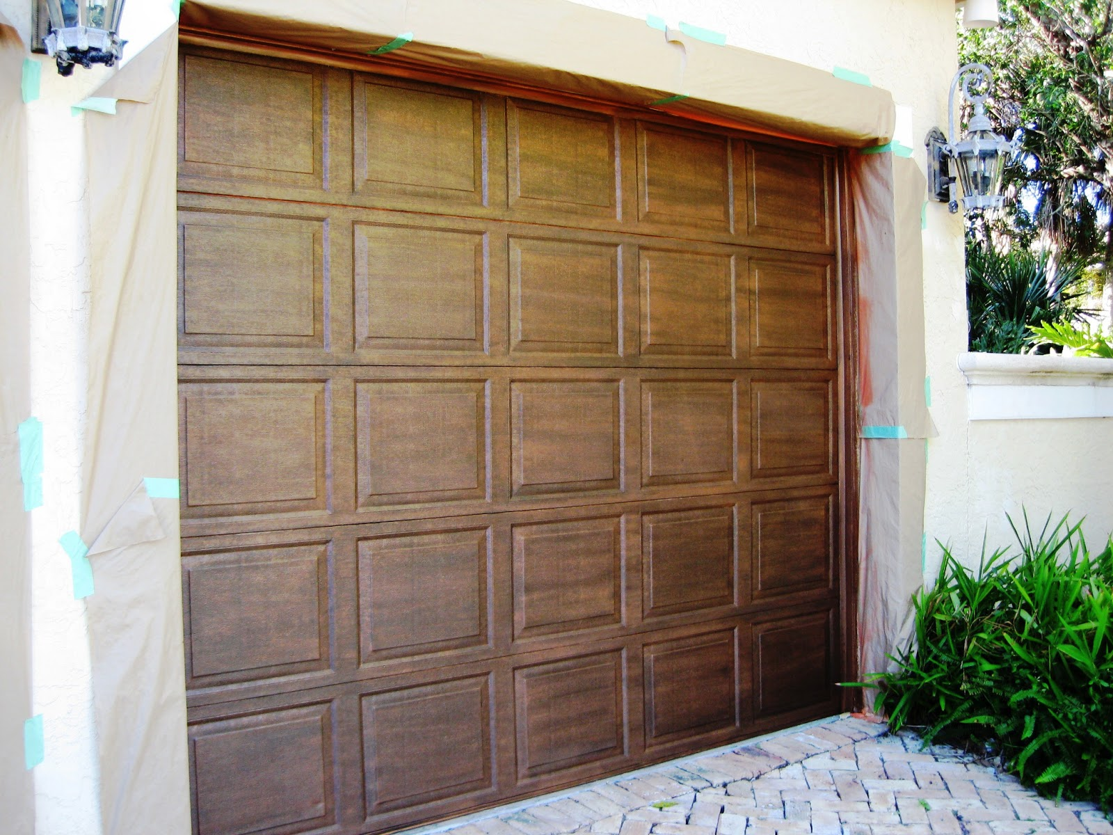 Array of color inc faux painted metal garage door for Garage door colors
