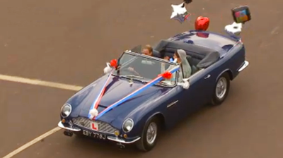 The newlyweds drive off on an Aston Martin. YouTube 2011.