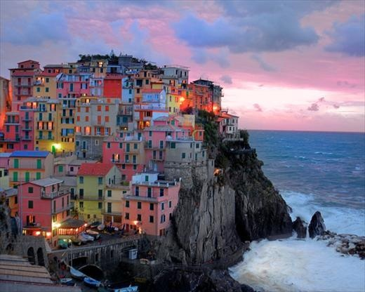 "The Cinque Terre is a rugged portion of coast on the Italian Riviera. It is in the Liguria region of Italy, to the west of the city of La Spezia. ""The Five Lands"" is composed of five villages: Monterosso al Mare, Vernazza, Corniglia, Manarola, and Riomaggiore. The coastline, the five villages, and the surrounding hillsides are all part of the Cinque Terre National Park and is a UNESCO World Heritage Site.  Over the centuries, people have carefully built terraces on the rugged, steep landscape right up to the cliffs that overlook the sea. Part of its charm is the lack of visible corporate development. Paths, trains and boats connect the villages, and cars cannot reach them from the outside. The Cinque Terre area is a very popular tourist destination.  The villages of the Cinque Terre were severely affected by torrential rains which caused floods and mudslides on October 25, 2011. Nine people have been confirmed killed by the floods, and damage to the villages, particularly Vernazza and Monterosso al Mare, was extensive."