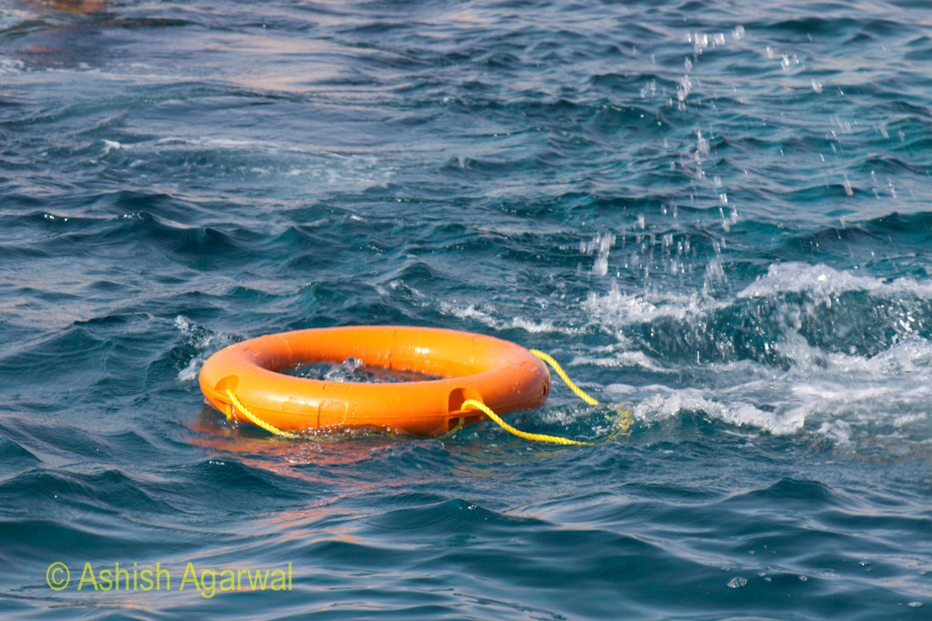 A flotation tube, where the person holding onto the tube suddenly ducked under the water surface