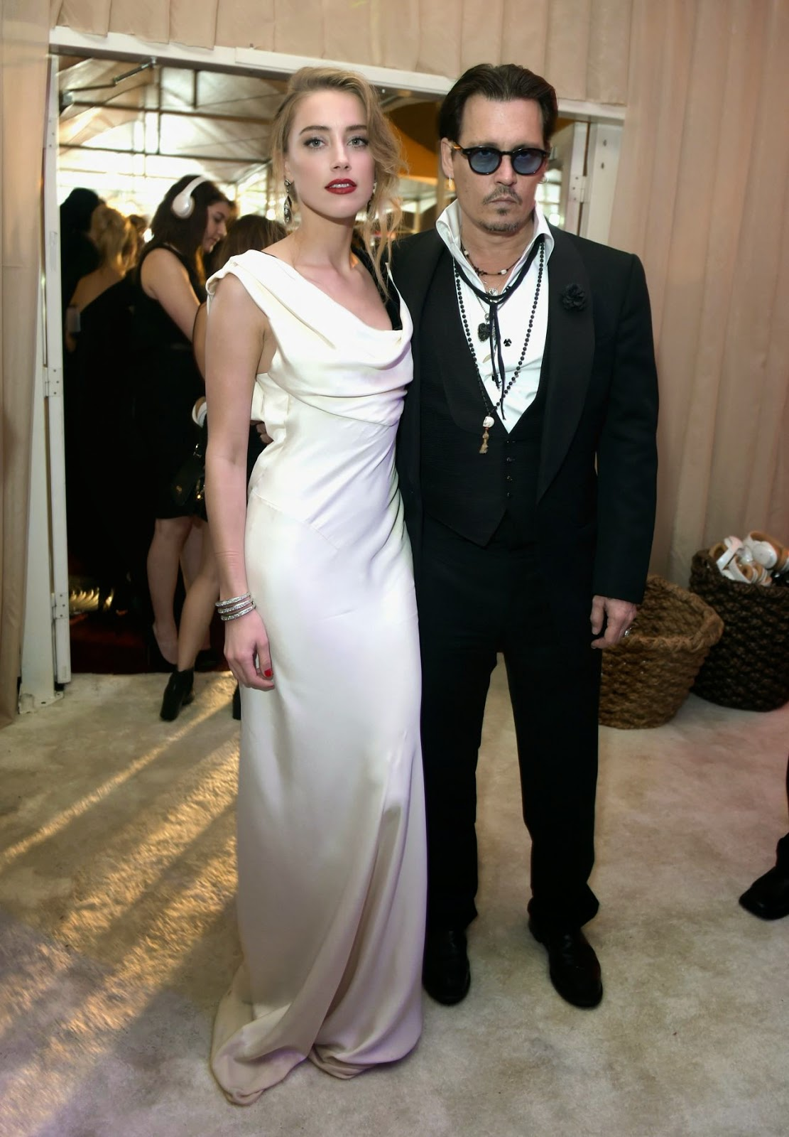 Amber Heard and Johnny Depp arrive in style at the Art of Elysium Annual Heaven Gala in LA