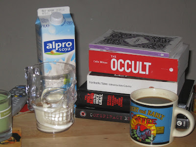 I call it Still Life With February Reading Pile and Breakfast