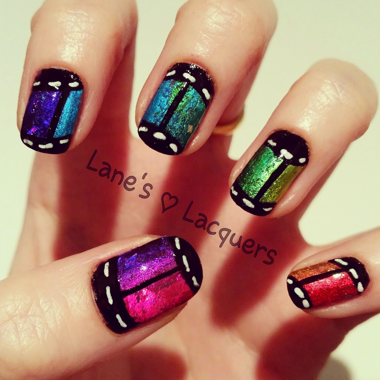 rainbow-foil-film-roll-freehand-nail-art