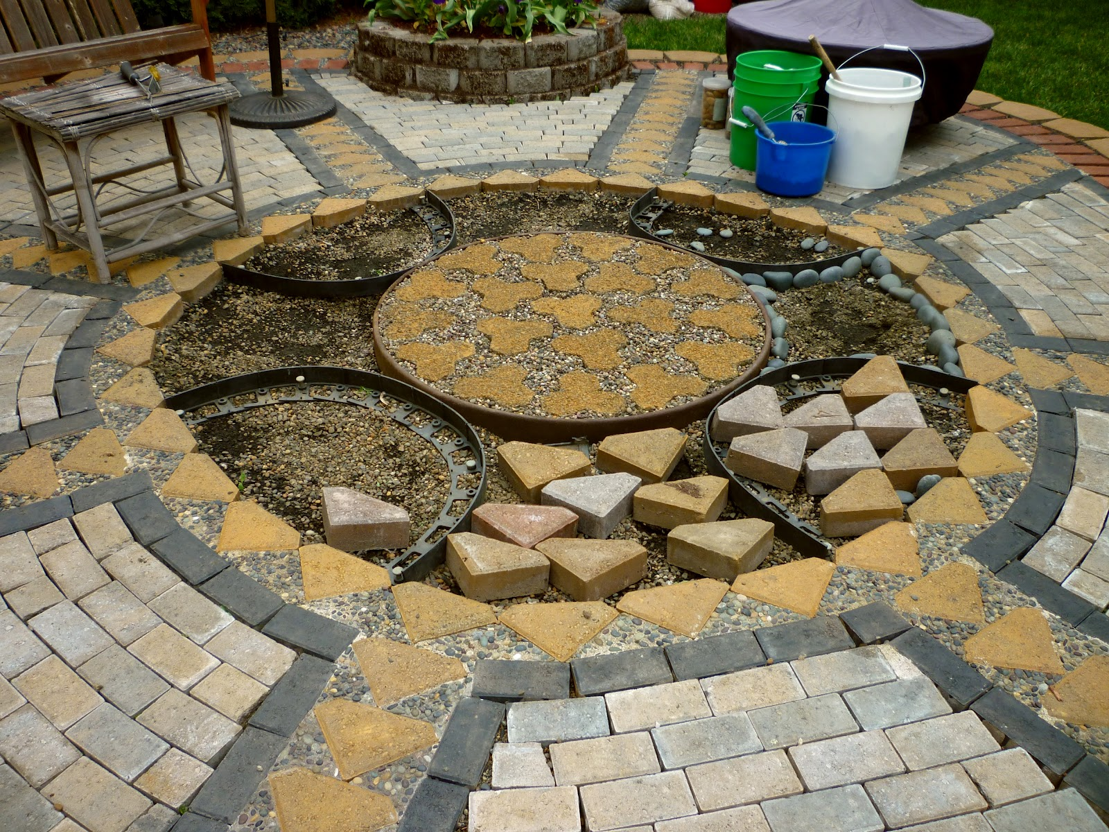 Wow thats a busy garden creating a paver and pebble for Paving stone garden designs